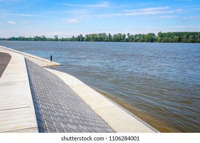 Man standing on a new embankment on the shore of river Danube in Vukovar, Croatia. Danube is Europes second longest river.