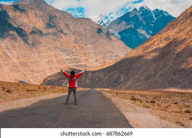 Man standing on Roadside of Karakorum Highway in Pakistan
