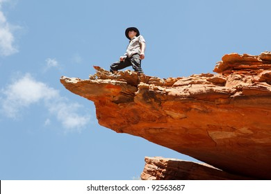 Man standing on the rock edge, Western Australia outback