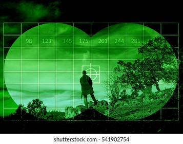 Man standing on the rock - view through night vision
