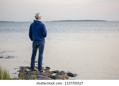 Man standing on the sea shore