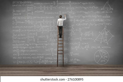 man standing on the stairs and writing mathematical equation