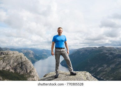 man standing on stone with great view on lysefjord