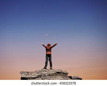 Man standing on the top of the mountain over night sky