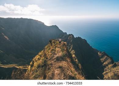 Man standing on top of ridge in Hawaii