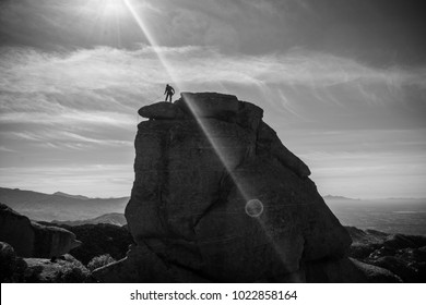 Man standing on top of rock pillar, Goose Head, Mt Lemmon, Tucson, AZ