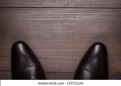 man standing on the wooden floor background