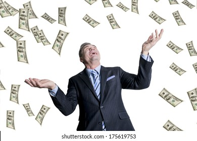 man standing with open arms amidst falling money