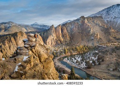 A man standing over the edge on Misery Ridge Trail, Smith Rock State Park, Oregon