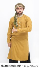 Man standing and posing in wearing kameez shalwar. Eid look. isolated on white background Eid mubarak offer. front veiw