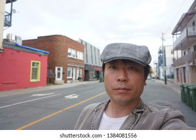 a man standing at rue alexandre of sherbrooke town on the townships trail of eastern townships in quebec, canada