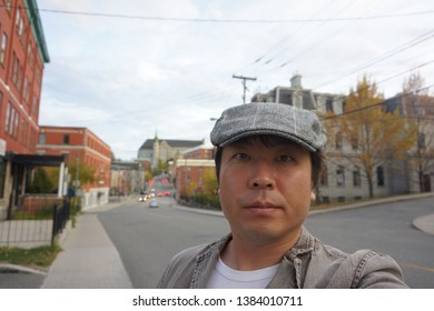 a man standing at rue dufferin of sherbrooke town on the townships trail of eastern townships in quebec, canada