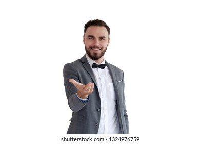 Man is standing and shows outstretched hand with open palm. Businessman hand touching virtual screen