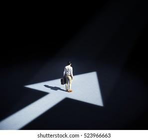 Man standing in a spotlight forming an arrow symbol - 3d illustration