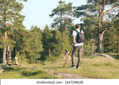 a man is standing with sticks for Nordic walking