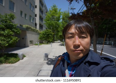 a man standing at street from daikanyama to shibuya in tokyo, japan
