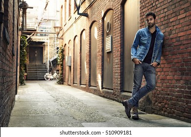 Man standing in street wearing denim, portrait