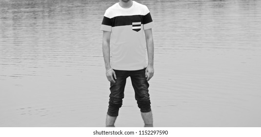 Man standing in the water wearing stylish fashionable dress unique photo