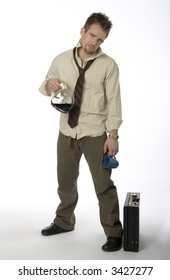 Man standing with wrinkled shirt, loose necktie, coffee pot, and briefcase