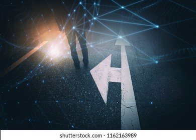Man stands alone on ashpalt road with intersection arrows signs on the floor. Conceptual business people cyberspace network net background.