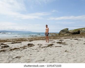 a man stands on a beach