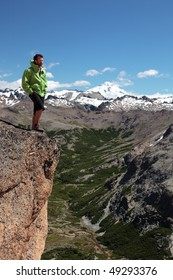 A man stands on the edge of an abyss in the Patagonia region of Argentina.