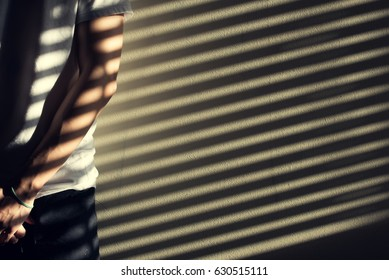 Man Stands in the Shadow Stripes.
