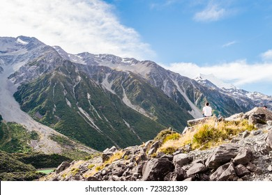 Man staring the beautiful mountains in New Zealand