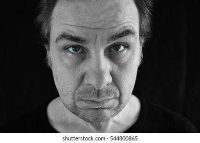 man staring with blue eyes