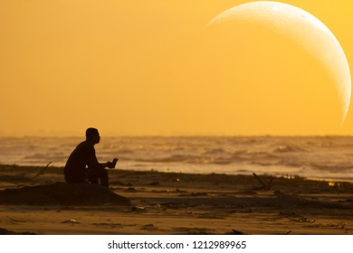 A man staring at the sea and a crescent moon - artist impression