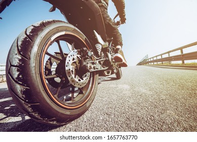 Man start with his motorbike. Outdoors adventures and freedom concept. Restart concept
