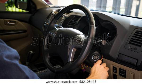 A man starting a car