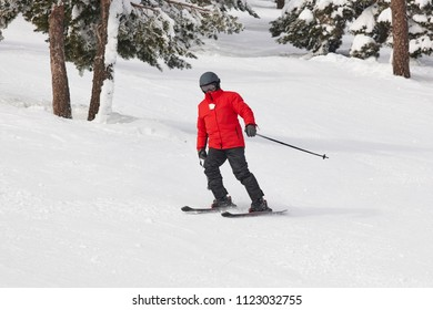 Man starting to learn how to ski. Winter sport. Horizontal