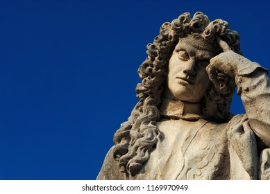 Man statue in the act of thinking against blue sky. Bernardo Nani monument erected in the 18th century in Padua, great venetian scholar (with copy space)