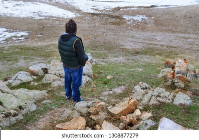 Man in the steppe looking at the winter landscape