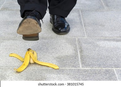 Man stepping on banana peel skin, copy space, work accident concept