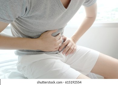 A man Stomach ache because of gastritis or  that are sign of stomach trouble. background white. Health concept