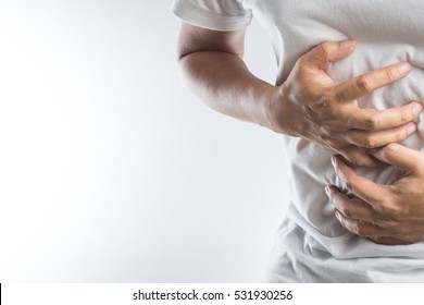 Man with stomach pain on white background