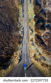 Man stood on a road with a drone bending inception effect