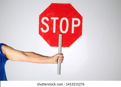 Man with Stop Sign. A red and white stop sign. hand held traffic control stop sign.