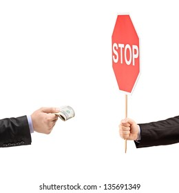 Man with a stop sign saying no to bribery, isolated on white background