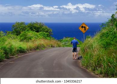 Man stopped at curve sign on Kamehameha highway at Halawa Molokai