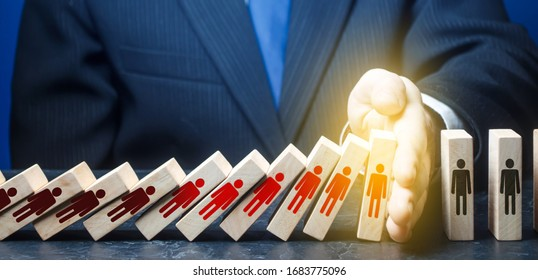 Man stops fall of dominoes represents infected people. COVID-19 virus pandemic. Stop new infections. Quarantine. Stop spread coronavirus exponential growth epidemic. Tough measures, control situation.