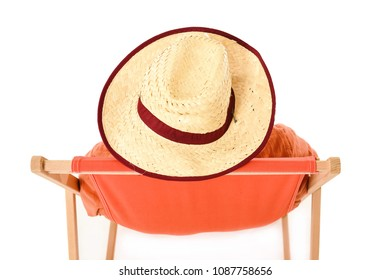 Man in straw hat sitting in deck chair from above. Space for text.