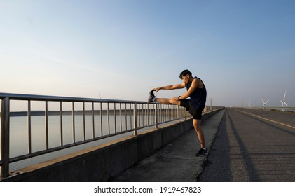 Man stretches the body before running. Fitness, jogging, running, exercise, lifestyle and healthy concept.
