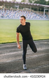 man stretches the body before running