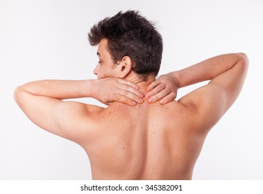 man stretches shoulder girdle