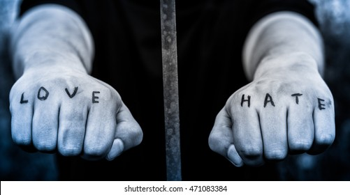 "Man stretching his arms forward. Hands clenched into fists. In the hands of inscribed words ""love"" and ""hate"""