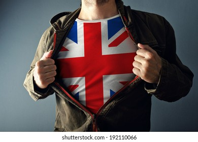 Man stretching jacket to reveal shirt with Great Britain flag printed, concept of Brexit or patriotism and national team supporting.