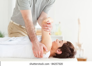 Man stretching a woman's arm in a room